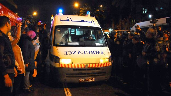 An ambulance rushes to the scene of a bus explosion in the center of the capital, Tunis, Tunisia, Tuesday, Nov. 24, 2015. - Sputnik Italia