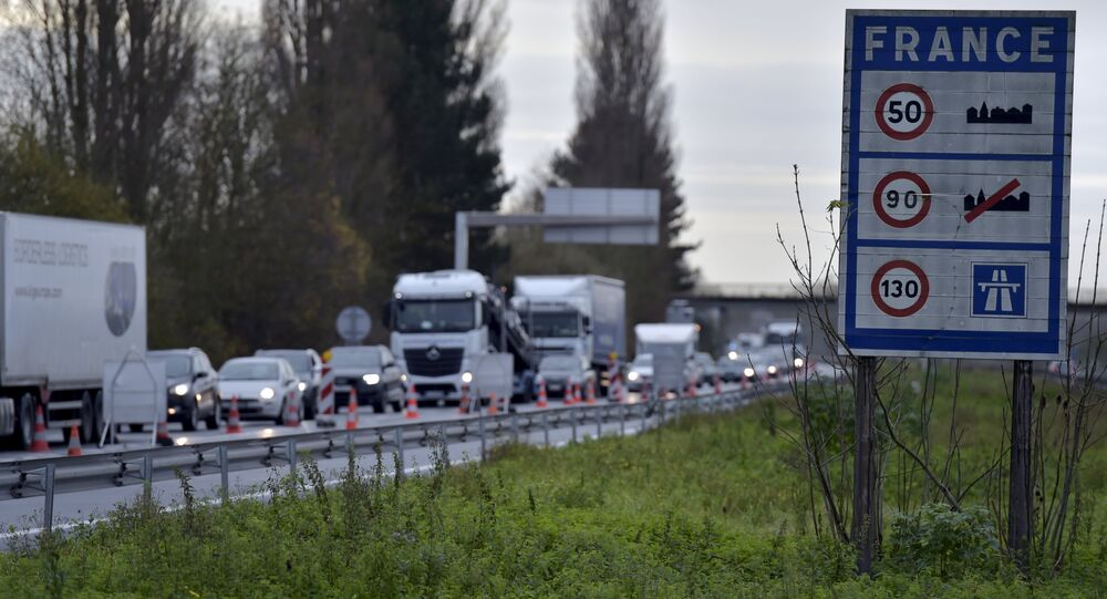 A view shows vehicles queueing in the highway from Paris to Brussels as Belgian and French police officers control the crossing of vehicles on the border between the two countries, following the deadly Paris attacks, in Crespin, France, November 14, 2015