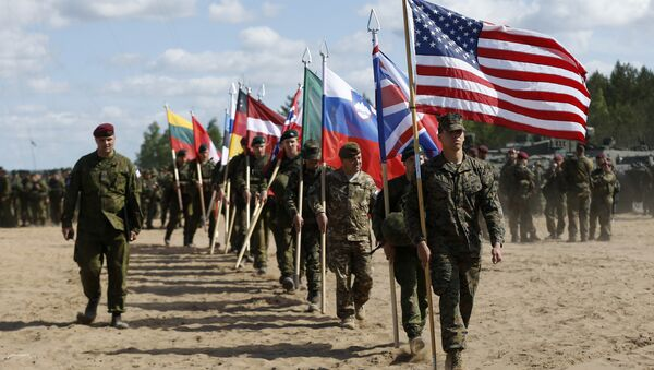 I soldati della NATO alla cerimonia dell' apertura delle esercitazioni 'Saber Strike 2015' in Lituania. - Sputnik Italia