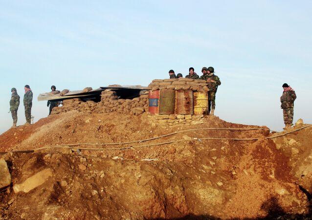 Kurdish peshmerga forces prepare for battle against the Islamic State group, near the Mosul Dam, in Iraq.