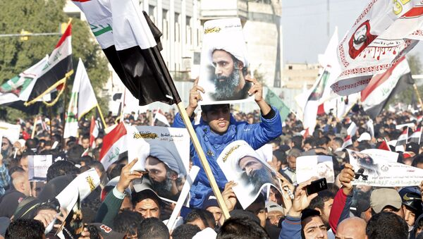 Supporters of Shi'ite cleric Moqtada al-Sadr protest against the execution of Shi'ite Muslim cleric Nimr al-Nimr in Saudi Arabia, during a demonstration in Baghdad January 4, 2016 - Sputnik Italia