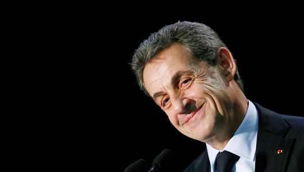 Nicolas Sarkozy, former French president and current UMP conservative political party head, attends a political rally in the Essonne department as he campaigns for French departmental elections in Palaiseau, near Paris, March 16, 2015. - Sputnik Italia