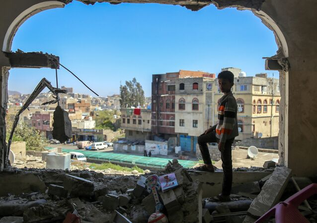 A Yemeni boy checks the damage following a mortar shell attack on the country's flashpoint southern city of Taez on February 3, 2016, as clashes between fighters from the Popular Resistance Committees, loyal to Yemen's fugitive President and Shiite Huthi rebels continue. The city of Taez is held by loyalists of Yemen's internationally recognised government, but it has been besieged by the Iran-backed rebels for months. Abedrabbo Mansour Hadi loyalists backed by a Saudi-led coalition have fought back and have been trying to retake Taez province and pave the way towards the rebel-held capital.