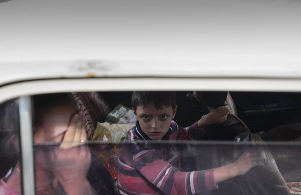 Profughi a Lugansk. - Sputnik Italia