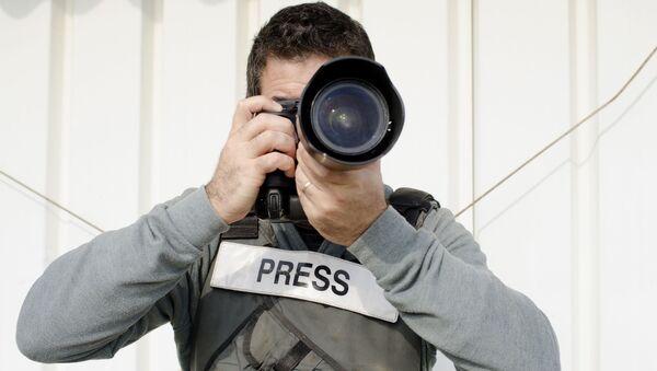 Un fotografo - Sputnik Italia