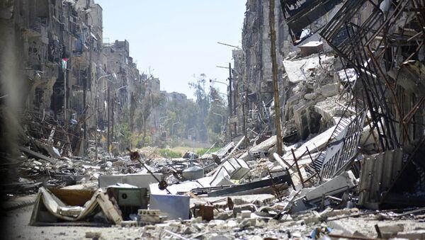 Immagini di distruzioni  nel campo di rifugio palestinese a Yarmouk. Damasco. - Sputnik Italia