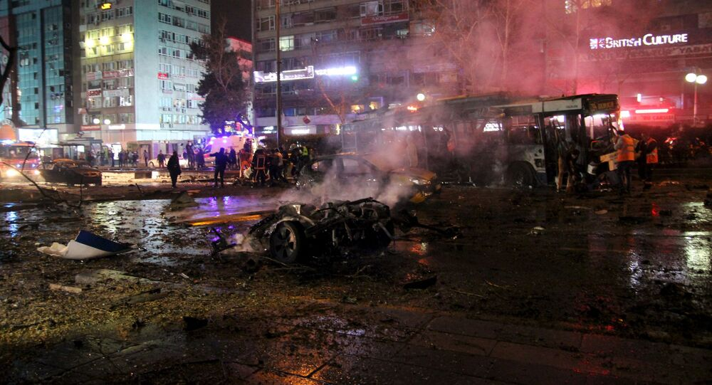 Emergency workers work at the explosion site in Ankara, Turkey March 13, 2016.