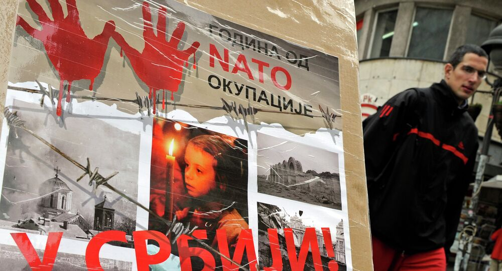 "A man walks past a poster with the reading ""Ten years of NATO occupation of Serbia"", and displaying images from 1999 NATO air campaign against Serbia and Montenegro, in Belgrade on March 23, 2009."