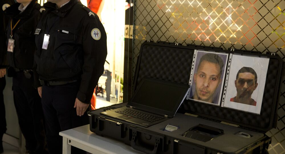 Police officers stand next to the wanted notice of terrorist Salah Abdeslam (L) and Mohamed Abrini on December 3, 2015 at the Roissy-Charles-de-Gaulle airport in Roissy-en-France, outside Paris.