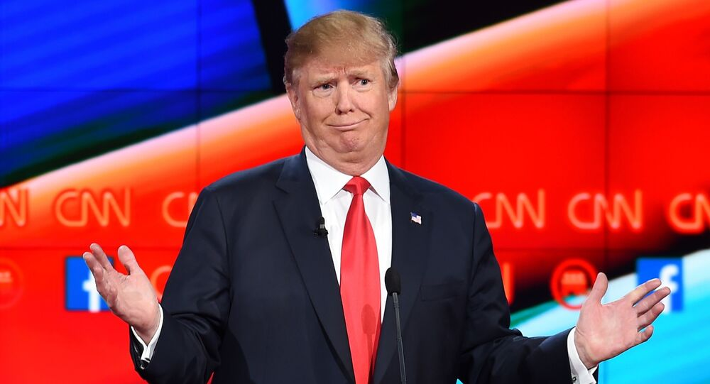 Republican presidential candidate businessman Donald Trump gestures during the Republican Presidential Debate, hosted by CNN, at The Venetian Las Vegas on December 15, 2015 in Las Vegas, Nevada.