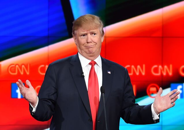 Republican presidential candidate businessman Donald Trump gestures during the Republican Presidential Debate, hosted by CNN, at The Venetian Las Vegas on December 15, 2015 in Las Vegas, Nevada.