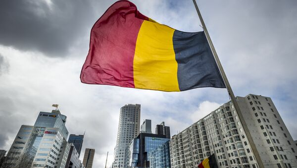 The Belgian flag flying at half-mast is pictured at the Hofplein in Rotterdam, on March 23, 2016. - Sputnik Italia