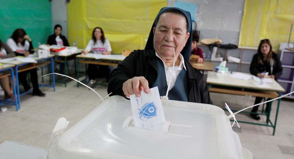 A nun casts her ballot at a polling station in Zahle during Lebanon's Bekaa municipal elections, May 8, 2016