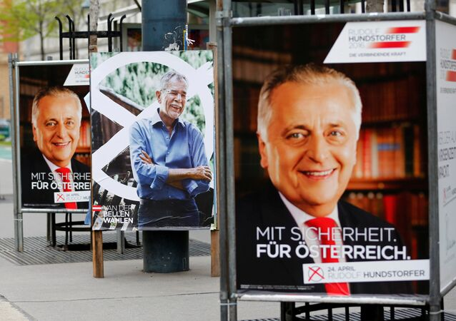 Election campaign posters of presidential candidates, Alexander Van der Bellen supported by the Green Party (C), and Rudolf Hundstorfer supported by the Social Democrats (SPOe), are seen in Vienna, Austria, April 11, 2016