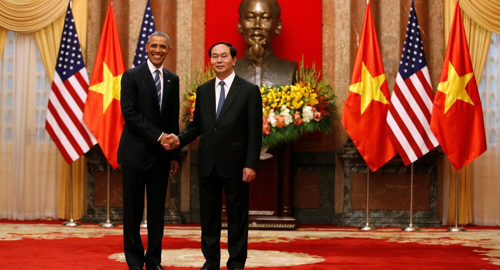 U.S. President Barack Obama shakes hands with Vietnam's President Tran Dai Quang after an arrival ceremony at the presidential palace in Hanoi, Vietnam May 23, 2016.