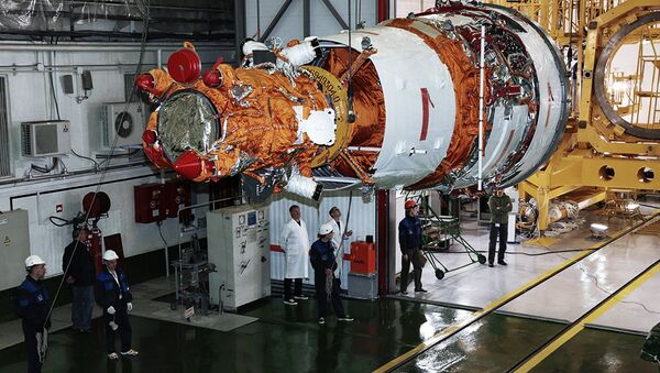 Rocket-and-space industry experts prepare the Resurs-P No. 3 remote-sensing Earth surface observation satellite for launch at Baikonur Cosmodrome. File photo - Sputnik Italia