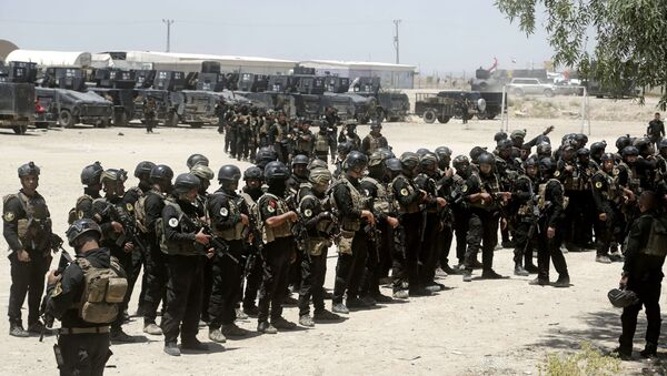 Iraq's elite counter-terrorism forces gather ahead of an operation to re-take the Daesh-held City of Fallujah, outside Fallujah, Iraq, Sunday, May 29, 2016. - Sputnik Italia