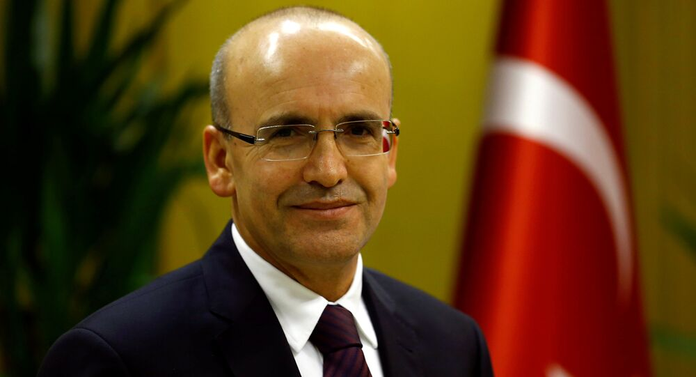 Turkish Deputy Prime Minister Mehmet Simsek poses during an interview with Reuters in Ankara, Turkey.