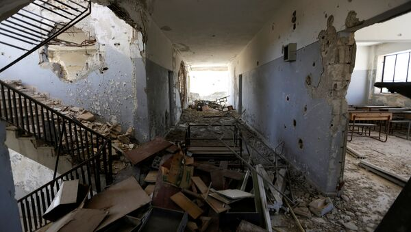 Damage is seen inside 'Syria, The Hope' school on the outskirts of the rebel-controlled area of Maaret al-Numan town, in Idlib province, Syria June 1, 2016 - Sputnik Italia