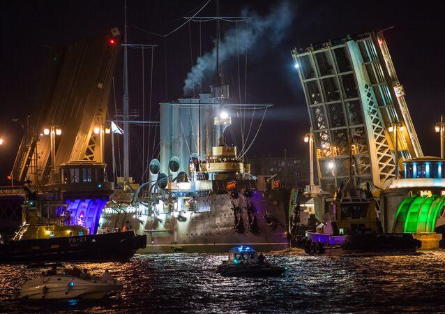 Cruiser Aurora towed to permanent mooring at Petrovskaya Embankment