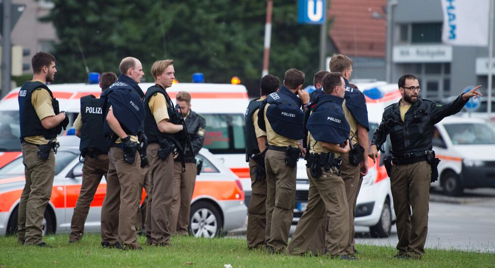 Police walks towards a shopping mall amid a shooting on July 22, 2016 in Munich