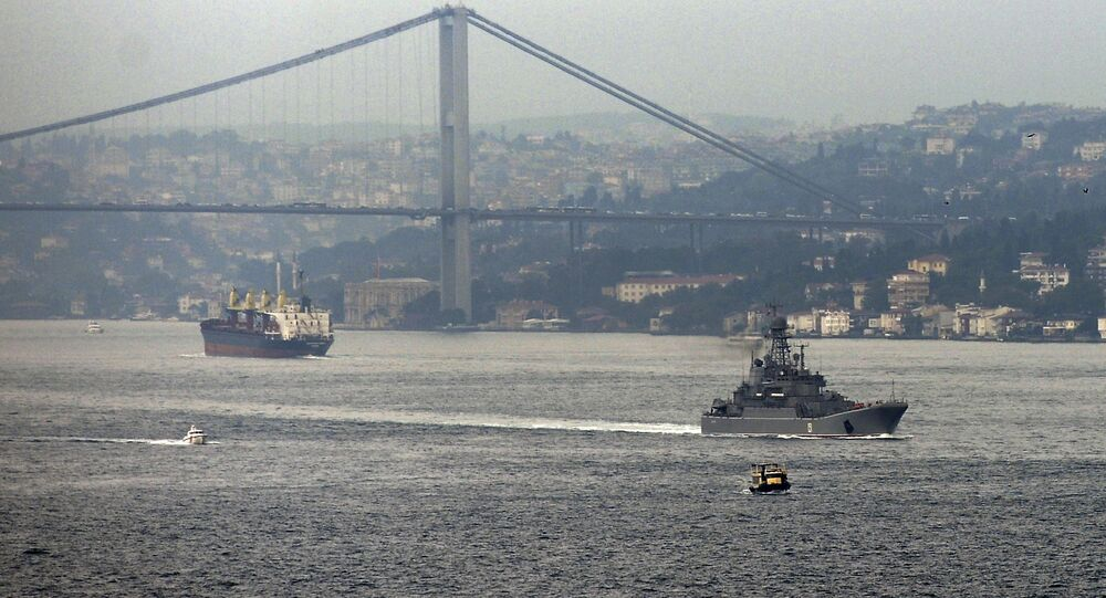 A Russian warship passes through the Bosphorus, in Istanbul, en route to the Mediterranean Sea, Tuesday, Oct. 6, 2015
