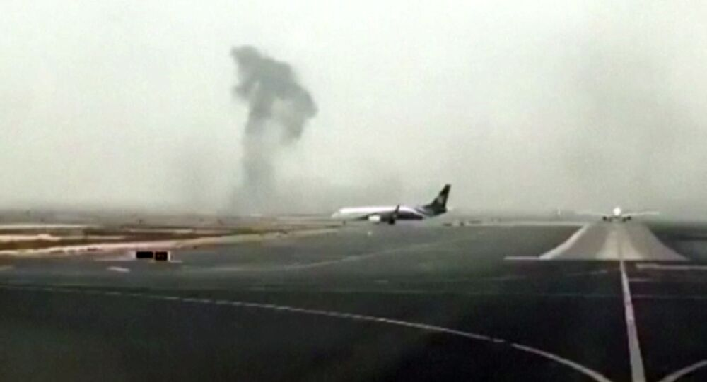 Smoke rising after an Emirates flight crash landed at Dubai International Airport