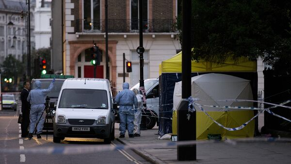 Police forensic officers work in Russell Square in London early on August 4, 2016, after a woman in her 60s was killed during a knife attack - Sputnik Italia