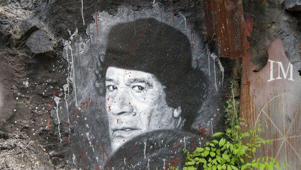 Murale con il ritratto di Gheddafi - Sputnik Italia