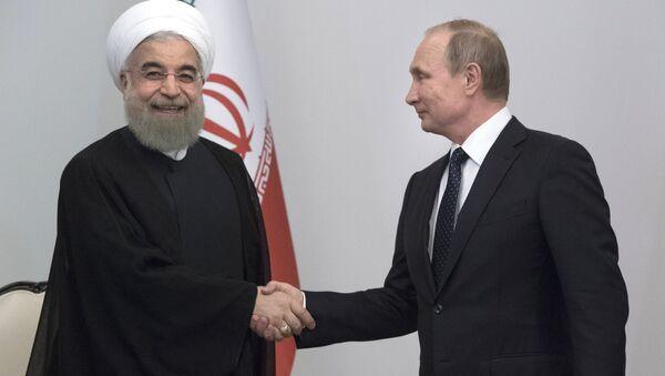 Президент Исламской Республики Иран Хасан Рухани и президент РФ Владимир Путин в Баку - Sputnik Italia