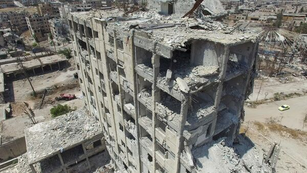 A destroyed building in the Bani Zeid district in north Aleppo - Sputnik Italia
