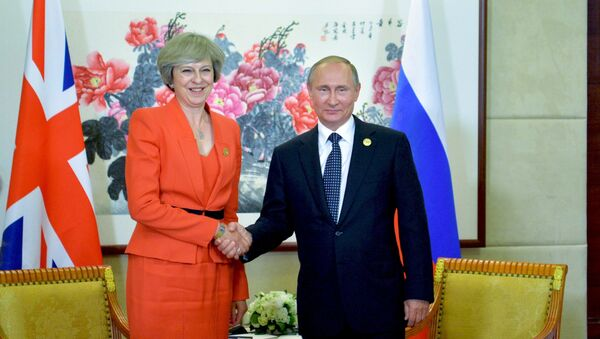 Incontro tra Vladimir Putin e Theresa May al G20 - Sputnik Italia