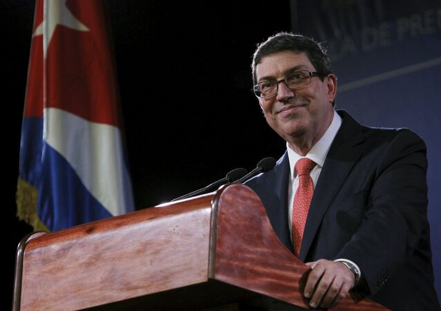 Cuba's Foreign Minister Bruno Rodriguez smiles while addressing the media in Havana