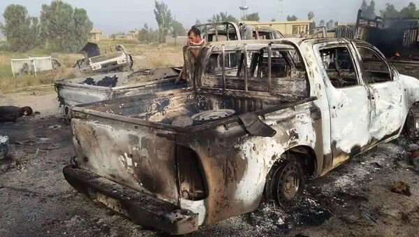 This image released by Iraq's Counterterrorism Service shows a destroyed militant vehicle after Coalition and Iraqi security forces targeted Islamic State fighters fleeing the outskirts of Fallujah, Iraq on Wednesday, June 29, 2016. - Sputnik Italia