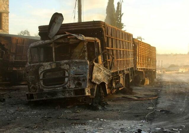 Damaged aid trucks are pictured after an airstrike on the rebel held Urm al-Kubra town, western Aleppo city, Syria September 20, 2016