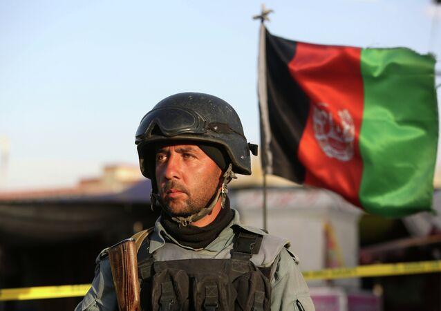 Afghan security forces inspect the site after a suicide car bombing attack in Kabul, Afghanistan, Tuesday, May 19, 2015.