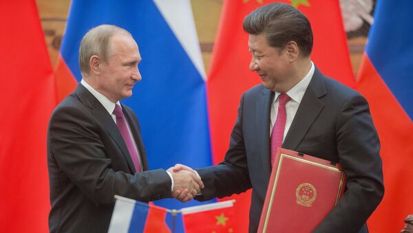Russian President Vladimir Putin, left, and President of the People's Republic of China Xi Jinping during a signing ceremony of documents following their talks in Beijing - Sputnik Italia