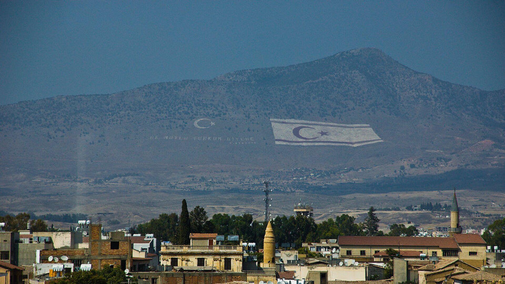 Flag of the self-declared Turkish Republic of Northern Cyprus in the hills above Cyprus' capital Nicosia. - Sputnik Italia, 1920, 22.07.2021