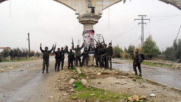 Syrian pro-government forces celebrate on a street in the town of Sheikh Miskeen in southern Daraa province on January 26, 2016 after they retook the strategic town from rebel forces - Sputnik Italia