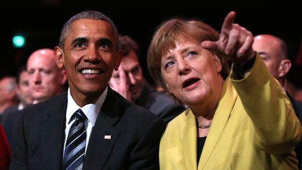 US President Barack Obama (L) and German Chancellor Angela Merkel sit during the official opening ceremony of the Hanover industry Fair at the Hannover Congress Center HCC in Hanover, on April 24, 2016 - Sputnik Italia