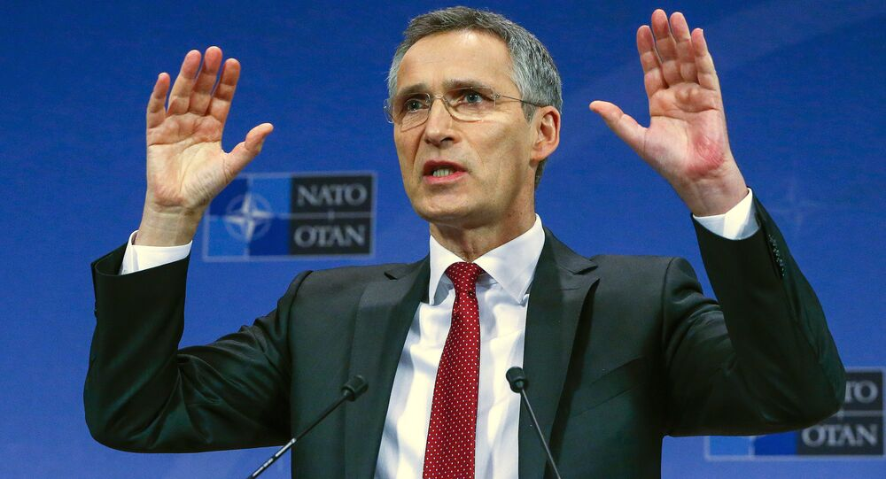 NATO Secretary-General Jens Stoltenberg gestures during a news conference ahead of a NATO defense ministers meeting, which will be held on February 10-11, at the Alliance's headquarters in Brussels, Belgium February 9, 2016.