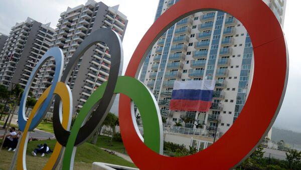 A Russian flag at the Olympic village in Rio de Janeiro - Sputnik Italia