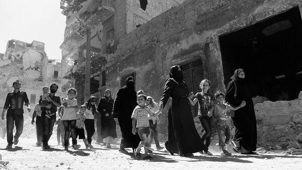 I civilli ad Aleppo - Sputnik Italia