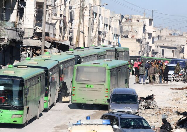 People get on buses to be evacuated from al-Sukkari rebel-held sector of eastern Aleppo, Syria December 15, 2016.