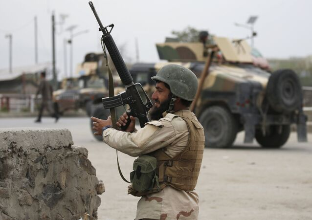 An Afghan National Army (ANA) soldier takes up position at the site of a suicide car bomb attack in Kabul, Afghanistan. (File)