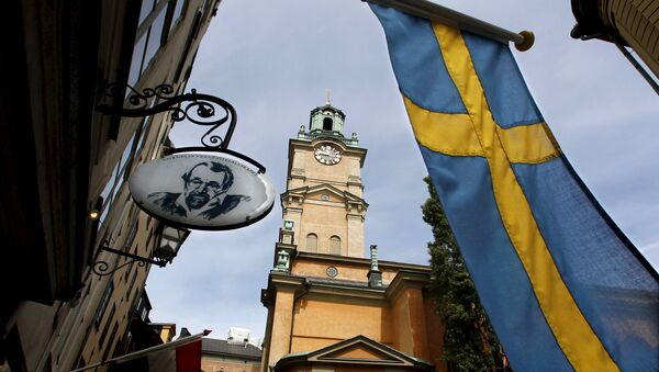 Sweden's flag is seen near the Stockholm Cathedral in Gamla Stan or the Old Town district of Stockholm, Sweden - Sputnik Italia