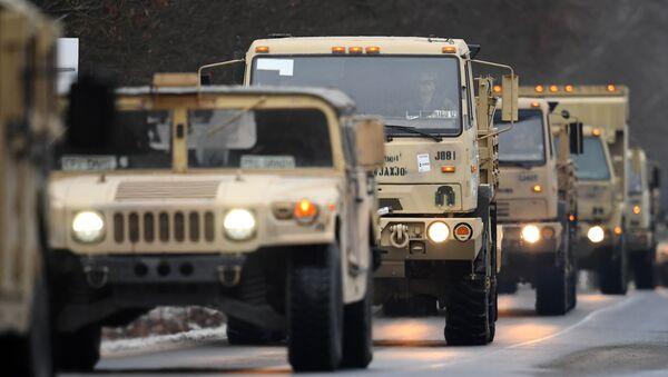 US military vehicles make their way on an army training camp near Brueck, northeastern Germany, on January 11, 2017 - Sputnik Italia