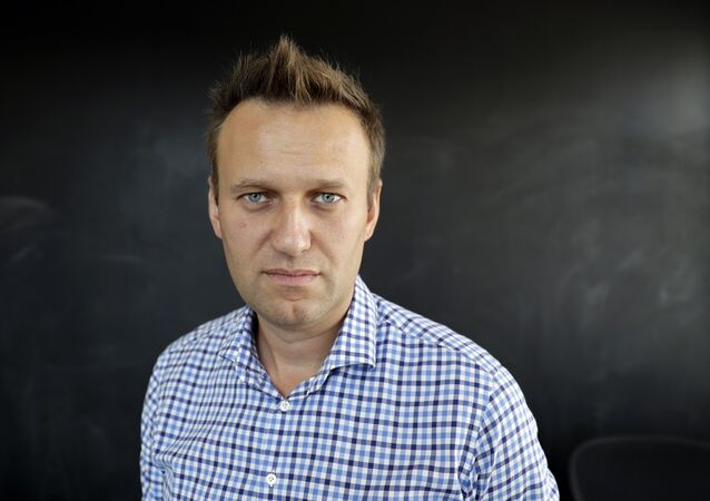 In this photo taken on Thursday, Sept. 1, 2016, Russian opposition activist Alexei Navalny speaks during an interview to the Associated Press in Moscow, Russia