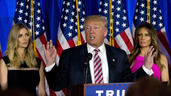 Donald Trump is joined by his daughter Ivanka, left, and wife Melania as he speaks during a news conference at the Trump National Golf Club Westchester, Tuesday, June 7, 2016, in Briarcliff Manor, NY. - Sputnik Italia