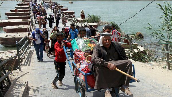 Profughi stanno lasciando la città irachena di Ramadi - Sputnik Italia
